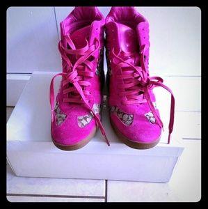 Barely worn fuschia coach wedge sneakers